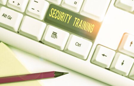 Conceptual hand writing showing Security Training. Concept meaning providing security awareness training for end users White pc keyboard with note paper above the white background Stock Photo