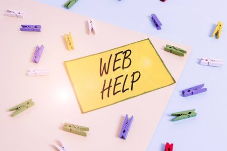 Word writing text Web Help. Business photo showcasing procedural or reference information delivered through computer Colored clothespin paper empty reminder yellow blue floor background office