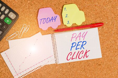 Text sign showing Pay Per Click. Business photo text Internet Advertising Model Search Engine marketing Strategy Desk notebook paper office cardboard paperboard study supplies table chart