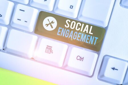 Writing note showing Social Engagement. Business concept for one s is degree of participation in a community or society Stock fotó
