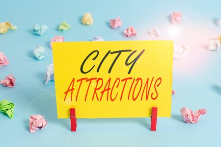 Text sign showing City Attractions. Business photo text place that showing visit for pleasure and interest Colored crumpled rectangle shaped reminder paper light blue background