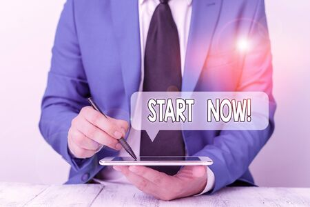 Text sign showing Start Now. Business photo text do not hesitate get working or doing stuff right away Businessman pointing with pen in empty copy space 版權商用圖片
