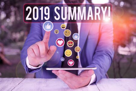 Writing note showing 2019 Summary. Business concept for summarizing past year events main actions or good shows