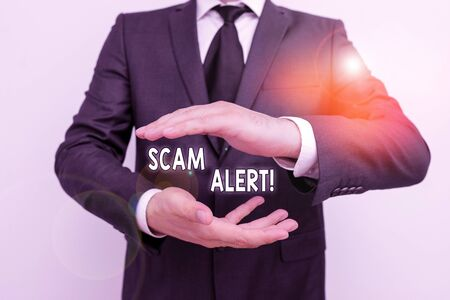 Handwriting text writing Scam Alert. Conceptual photo fraudulently obtain money from victim by persuading him Male human with beard wear formal working suit clothes raising one hand up