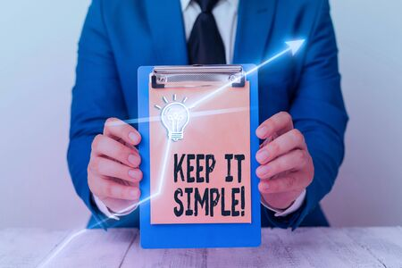 Writing note showing Keep It Simple. Business concept for ask something easy understand not go into too much detail