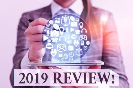 Word writing text 2019 Review. Business photo showcasing remembering past year events main actions or good shows Banco de Imagens