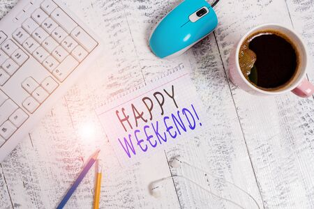 Text sign showing Happy Weekend. Business photo showcasing something nice has happened or they feel satisfied with life technological devices colored reminder paper office supplies keyboard mouse Фото со стока
