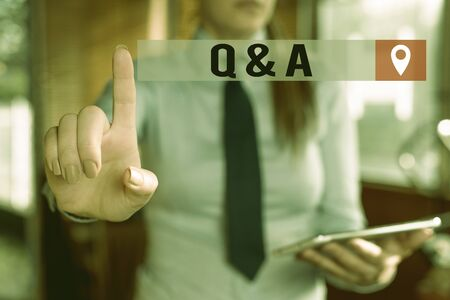 Handwriting text writing Q And A. Conceptual photo defined as questions being asked and answers Blurred woman in the background pointing with finger in empty space