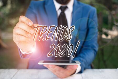 Word writing text Trends 2020. Business photo showcasing general direction in which something is developing or changing Businessman pointing with pen in empty copy space