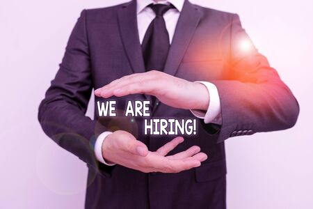 Handwriting text writing We Are Hiring. Conceptual photo recently you employ someone or pay someone to do particular job Male human with beard wear formal working suit clothes raising one hand up