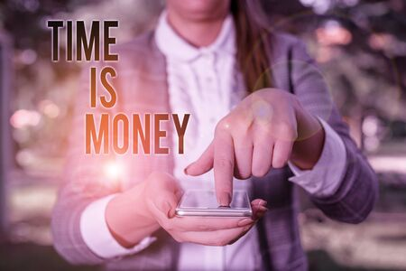 Word writing text Time Is Money. Business photo showcasing Better to do things as quickly as possible Do not delay Woman in grey suites holds mobile phone