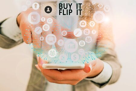 Writing note showing Buy It Flip It. Business concept for Buy something fix them up then sell them for more profit Stock fotó