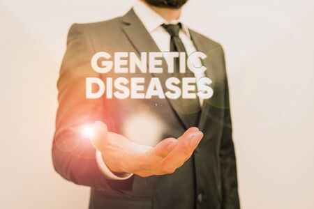 Conceptual hand writing showing Genetic Diseases. Concept meaning disease caused by an abnormality in an individual s is genome Male human with beard wear formal working suit clothes hand