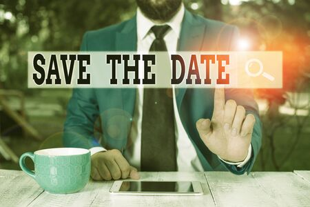 Text sign showing Save The Date. Business photo text Systematized events Scheduled activity Recorded Filed Businessman with pointing finger in front of him Imagens