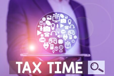 Word writing text Tax Time. Business photo showcasing compulsory contribution state revenue levied government on workers Stock fotó