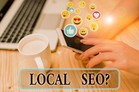 Writing note showing Local Seoquestion. Business concept for incredibly effective way to market your local business online