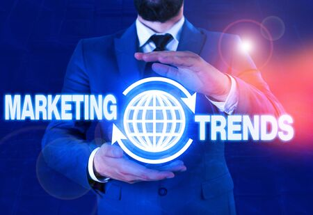 Writing note showing Marketing Trends. Business concept for changes and developments in trading in the market