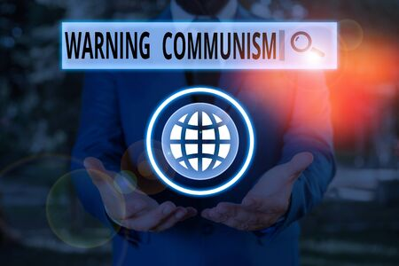 Word writing text Warning Communism. Business photo showcasing economic system where the group owns the production Reklamní fotografie