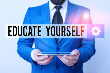Text sign showing Educate Yourself. Business photo text To train or prepare oneself in a particular area or subject Businessman in blue suite with a tie holds lap top in hands Stock fotó