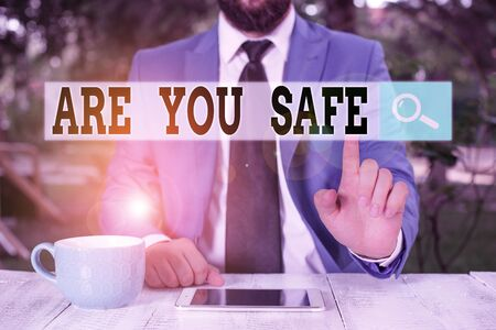 Text sign showing Are You Safe. Business photo text Free from danger Not anticipating any Harm Hurt physically Businessman with pointing finger in front of him