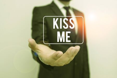 Writing note showing Kiss Me. Business concept for informally request to touch my lips with your lips or press against Male human with beard wear formal working suit clothes hand