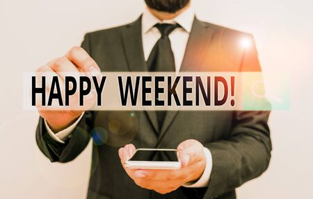 Text sign showing Happy Weekend. Business photo showcasing something nice has happened or they feel satisfied with life Male human wear formal work suit hold smart hi tech smartphone use one hand