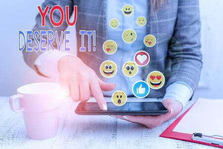 Text sign showing You Deserve It. Business photo showcasing should have it because of their qualities or actions Imagens