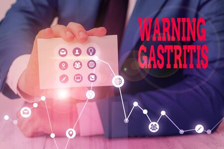 Conceptual hand writing showing Warning Gastritis. Concept meaning early advice on inflammation of the lining of the stomach Standard-Bild