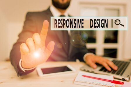 Word writing text Responsive Design. Business photo showcasing web page creation that makes use of flexible layouts Male human wear formal clothes present presentation use hi tech smartphone Stock Photo - 135408772