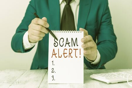 Text sign showing Scam Alert. Business photo showcasing fraudulently obtain money from victim by persuading him Man holds empty paper with copy space in front of him Copy Space