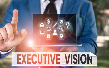 Conceptual hand writing showing Executive Vision. Concept meaning inspires those around them to move toward Creates solution 写真素材