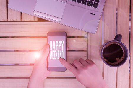 Text sign showing Happy Weekend. Business photo showcasing something nice has happened or they feel satisfied with life woman computer smartphone drink mug office supplies technological devices