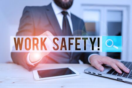Word writing text Work Safety. Business photo showcasing policies and procedures in place to ensure health of employees Male human wear formal clothes present presentation use hi tech smartphone