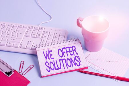 Word writing text We Offer Solutions. Business photo showcasing way to solve problem or deal with difficult situation Paper blue desk computer keyboard office study notebook chart numbers memo