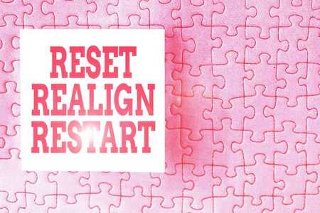 Text sign showing Reset Realign Restart. Business photo showcasing Life audit will help you put things in perspectives Piece of square note paper use for give notation stick to puzzle background