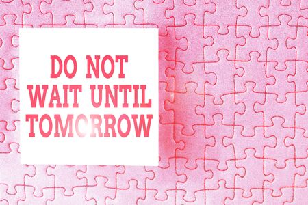 Text sign showing Do Not Wait Until Tomorrow. Business photo showcasing needed to do it right away Urgent Better do now Piece of square note paper use for give notation stick to puzzle background