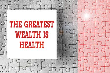 Text sign showing The Greatest Wealth Is Health. Business photo showcasing Many sacrifice their money just to be healthy Piece of square note paper use for give notation stick to puzzle background