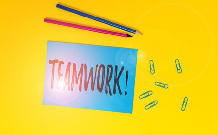 Conceptual hand writing showing Teamwork. Concept meaning combined action of group especially when effective and efficient Blank paper sheet message reminder pencils clip colored background