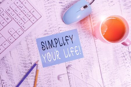 Word writing text Simplify Your Life. Business photo showcasing focused on important and let someone else worry about less ones technological devices colored reminder paper office supplies keyboard mouse Foto de archivo - 135536819
