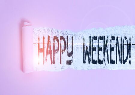 Handwriting text Happy Weekend. Conceptual photo something nice has happened or they feel satisfied with life Cardboard which is torn in the middle placed above a wooden classic table