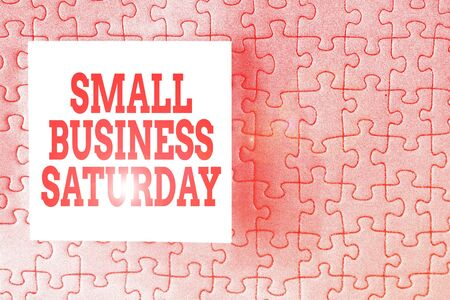 Text sign showing Small Business Saturday. Business photo showcasing American shopping holiday held during the Saturday Piece of square note paper use for give notation stick to puzzle background
