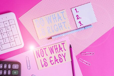 Text sign showing Do What Is Right Not What Is Easy. Business photo showcasing willing to stand up for what is right Writing equipments and computer stuffs placed above colored plain table