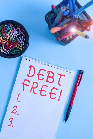 Handwriting text writing Debt Free. Conceptual photo does not owning any money or things to any individual or companies Notebook and writing equipment with computer mouse above pastel backdrop