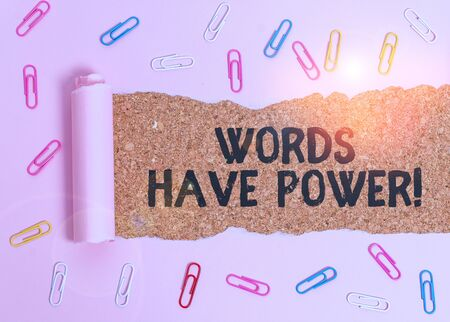 Conceptual hand writing showing Words Have Power. Concept meaning as they has ability to help heal hurt or harm someone Paper clip and torn cardboard on wood classic table backdrop