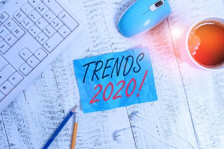 Handwriting text writing Trends 2020. Conceptual photo general direction in which something is developing or changing technological devices colored reminder paper office supplies keyboard mouse