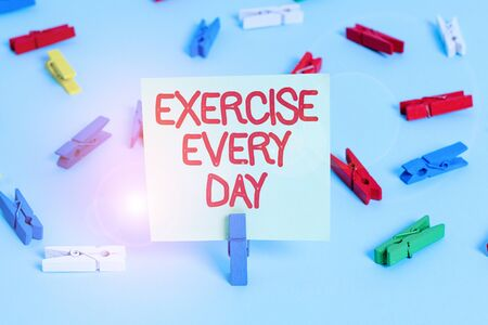 Word writing text Exercise Every Day. Business photo showcasing move body energetically in order to get fit and healthy Colored clothespin papers empty reminder blue floor background office pin