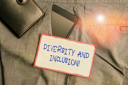 Handwriting text writing Diversity And Inclusion. Conceptual photo range huanalysis difference includes race ethnicity gender Smartphone device inside trousers front pocket with wallet and note paper