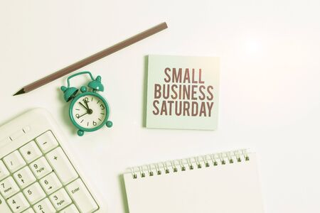 Handwriting text writing Small Business Saturday. Conceptual photo American shopping holiday held during the Saturday White pc keyboard with empty note paper and pencil above white background