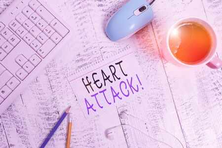 Text sign showing Heart Attack. Business photo showcasing sudden occurrence of coronary thrombosis resulting in death technological devices colored reminder paper office supplies keyboard mouse