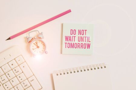 Handwriting text writing Do Not Wait Until Tomorrow. Conceptual photo needed to do it right away Urgent Better do now White pc keyboard with empty note paper and pencil above white background